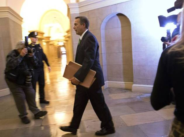 Speaker of the House John Boehner, R-Ohio, on his way to last-minute fiscal cliff talks. Image from Jacquelyn Martin (AP)