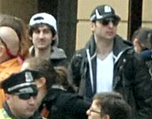The image from the Boston Marathon used by the FBI to identify suspects Dzhokhar Tsarnaev, age 19 (at left, in white) and Tamerlan Tsarnaev, age 26 (at right, in black). Image from FBI.gov.