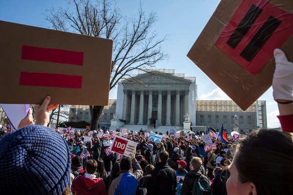 Demonstrators wait in front of the Supreme Court to hear their ruling on gay marriage. Image from the New York Times.