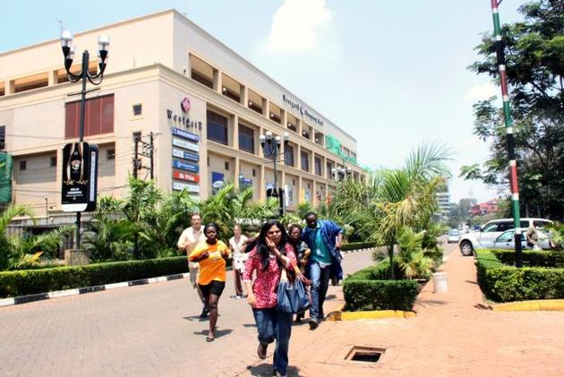Survivors of the attack on Westgate Mall in Nairobi flee the shootings. Image from the Associated Press.