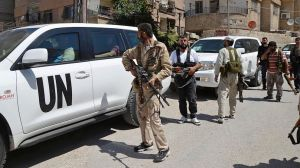 UN chemical weapons inspectors escorted by Free Syrian Army fighters. Image by Bassam Khabieh for Reuters