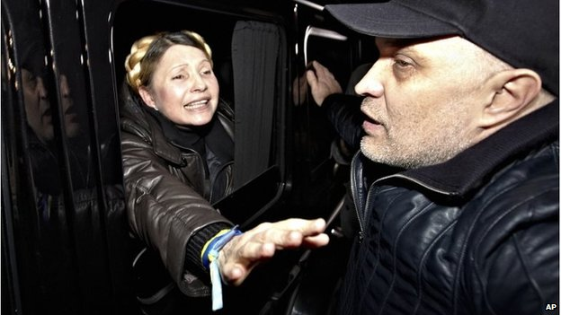 Former Ukrainian Prime Minister Yulia Tymoshenko waves to supporters after being released from prison. Image from the Associated Press.