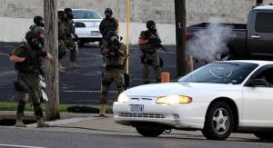 Scenes like this caught national attention and led many to question how police respond to emergencies. Image from Jeff Roberson/AP