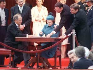 Queen Elizabeth II signs the Constitution Act in 1982 image from the National Post